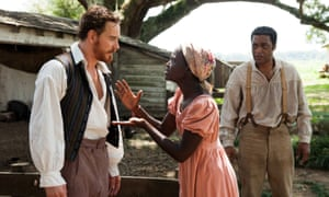 Michael Fassbender, Lupita Nyong'o and Chiwetel Ejiofor in 12 Years a Slave.