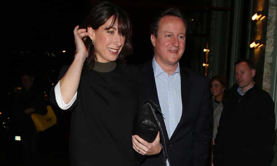 David and Samantha Cameron outside Mayfair restaurant Sexy Fish after Rupert Murdoch's Christmas bash.