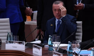 President Recep Tayyip Erdogan attends a working session on the first day of the G20 summit. 'World leaders meeting at the G20 must stand up for Turkey's beleaguered civil society now.'
