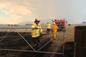 RFS crews put out spot fires ahead of the main fire front at the North Black Range.