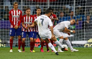 Cristiano Ronaldo fires the free-kick into the wall.