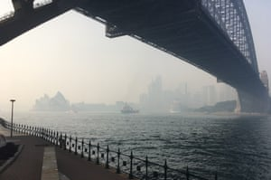 The Sydney Harbour Bridge and Opera House blanketed by bushfire smoke on Thursday