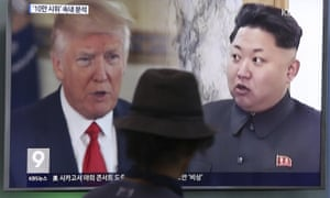 A man in Seoul, South Korea, watches a a news programme showing Donald Trump and Kim Jong-un.