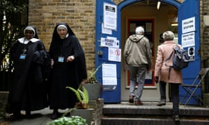 Nuns from the Tyburn Convent leave a polling station in London.