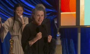 Frances McDormand, winner of the best actress award for Nomadland, with director Chloé Zhao in the background.