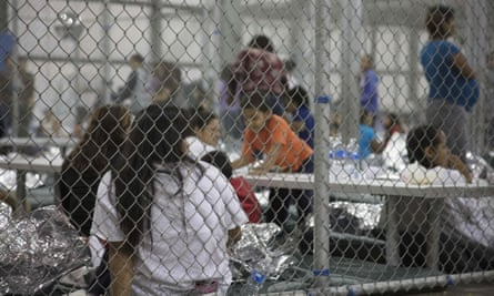 People are held by US Border Patrol agents at the Central Processing Center in McAllen, Texas.