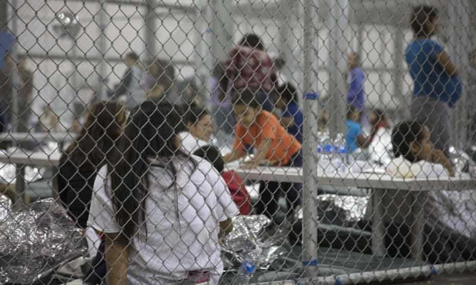 A June photo released by US Customs and Border Protection (CBP) shows undocumented people at the central processing center in McAllen, Texas.