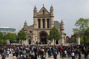 A crowd gathers outside St Anne's Cathedral to listen to the service