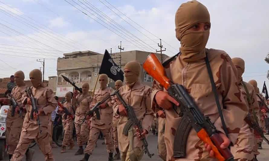 """Boys known as the """"caliphate cubs"""" hold rifles during a parade near Mosul in Iraq."""