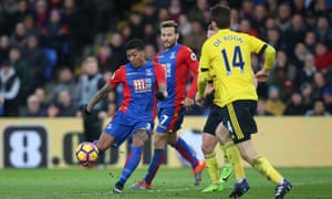 Patrick van Aanholt (left)scores the only goal of the game to earn Crystal Palace a vital victory.