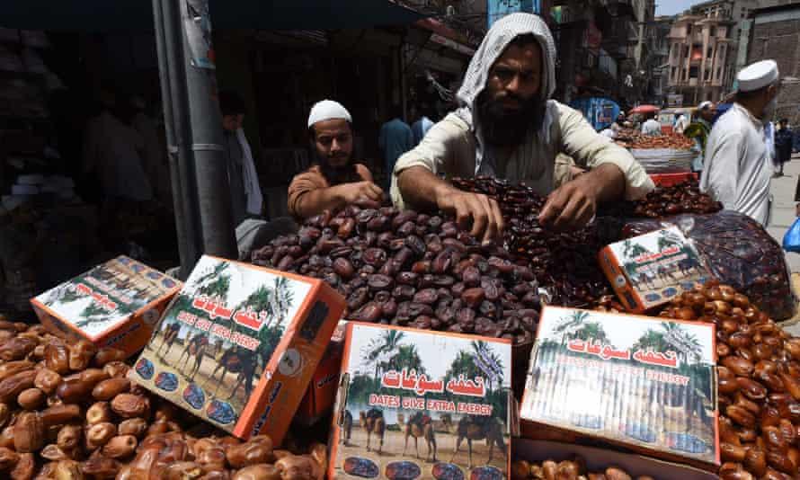 A Pakistani vendor arranges dates at a market ahead of Ramadan.