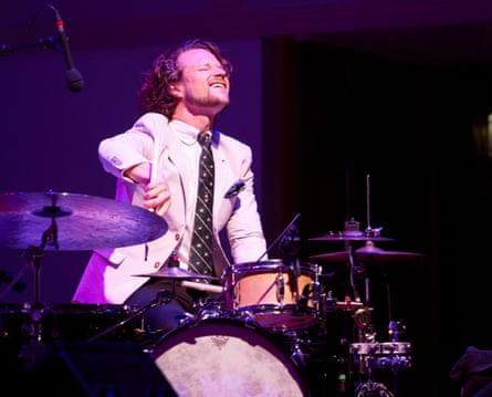 Anton Eger … rattling rim-shots and thrashing cymbals.