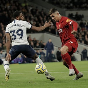 Firmino turns away from Japhet Tanganga before scoring the only goal of the game against Tottenham.