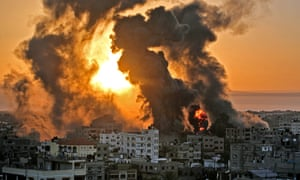 A fire rages at sunrise in Khan Yunish following an Israeli airstrike on targets in the southern Gaza strip, early on May 12