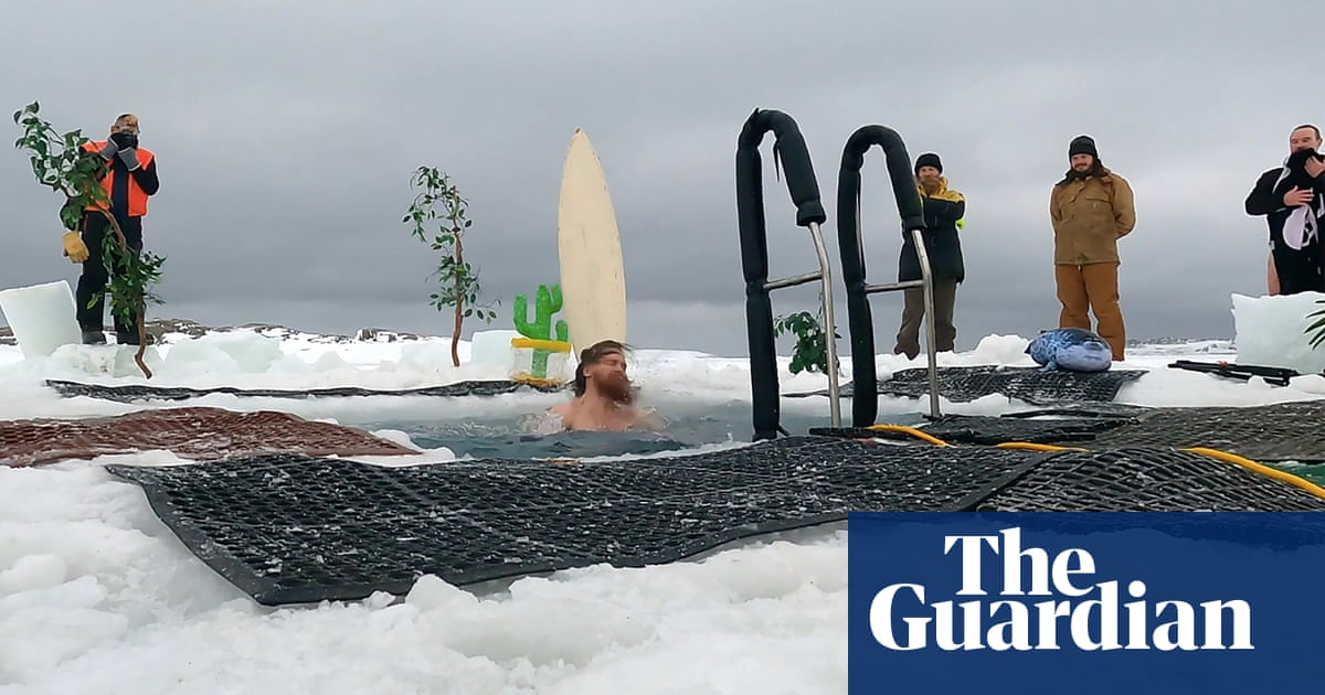 'Bracing minus 2C': expeditioners in Antarctica mark solstice with icy polar plunge