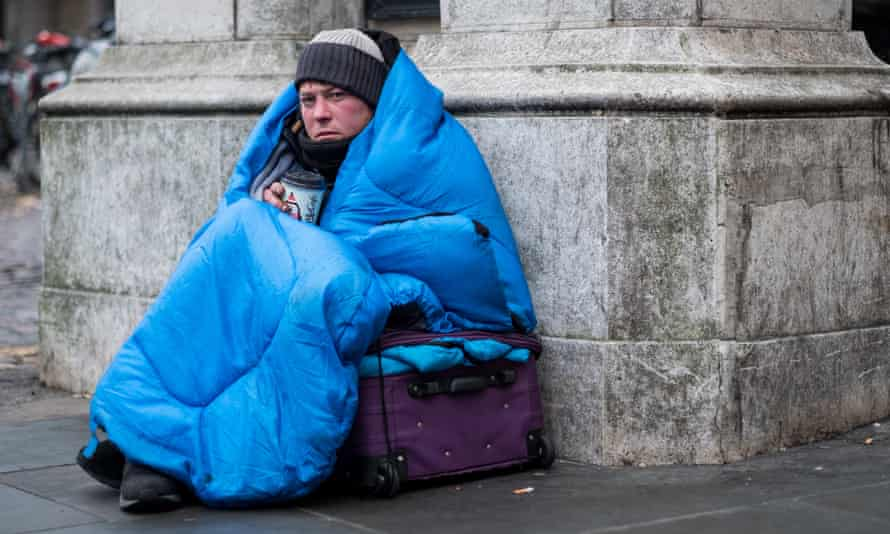 Homeless man on London street