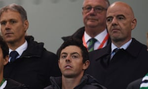 Gianni Infantino watches Northern Ireland's game with San Marino sat behind Rory McIlroy