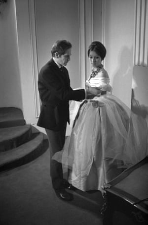 Cardin with a model before the presentation of his new collection in 1963