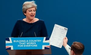 Tory meltdown … a prankster interrupts Theresa May's conference speech to hand her fake P45.