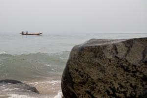 Two fishermen in wooden canoe off Monrovia