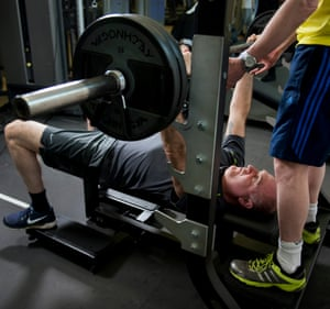 John Crace and his friend Alex lifting weights in the gym