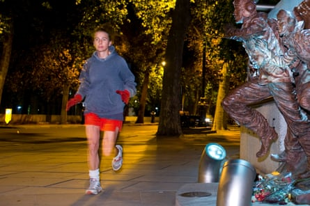 Lionel Shriver runs past Battle of Britain memorial in London