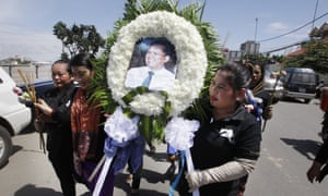 Mourners line up at a funeral ceremony for Kem Ley in Phnom Penh.