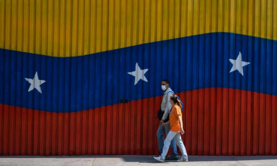 A couple wearing face masks in Caracas, Venezuela, on 17 April.