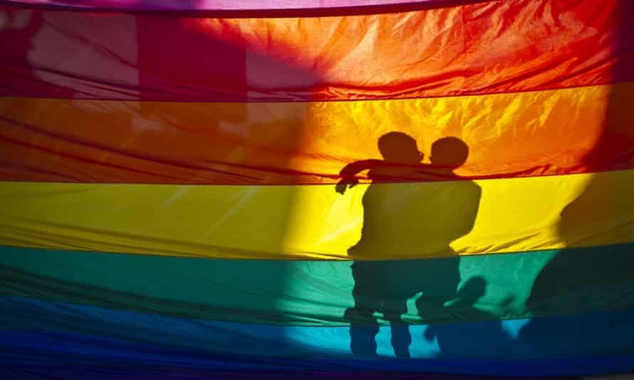 Shadow of couple through rainbow flag