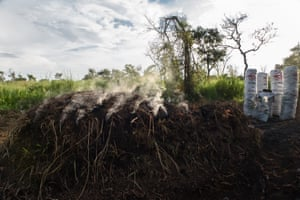 Wood in the process of carbonization under a mound of earth and grass. Amuru District, Northern Uganda