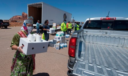 Miss Navajo Nation Shaandiin Parrish delivers food and household items to families in need outside Monument Valley Tribal Park, which has been closed due to Covid-19 in Arizona