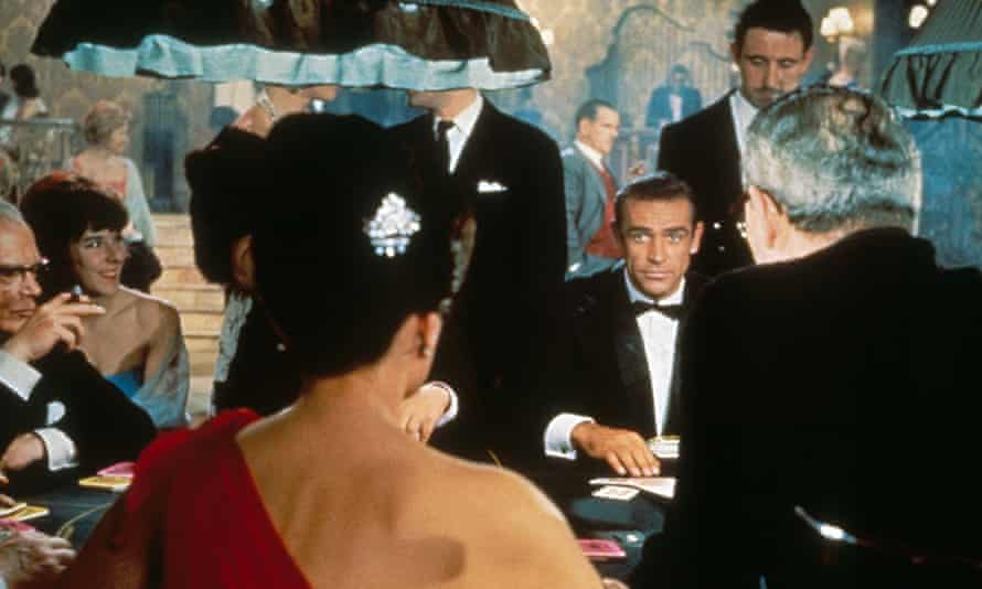 Sean Connery in Dr No, 1962, the first film featuring Ian Fleming's secret agent, with Eunice Gayson playing Sylvia Trench.