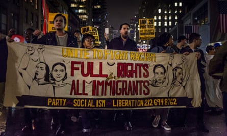 Thousands of anti-Donald Trump protesters march down the street in New York the day after he won the US election.