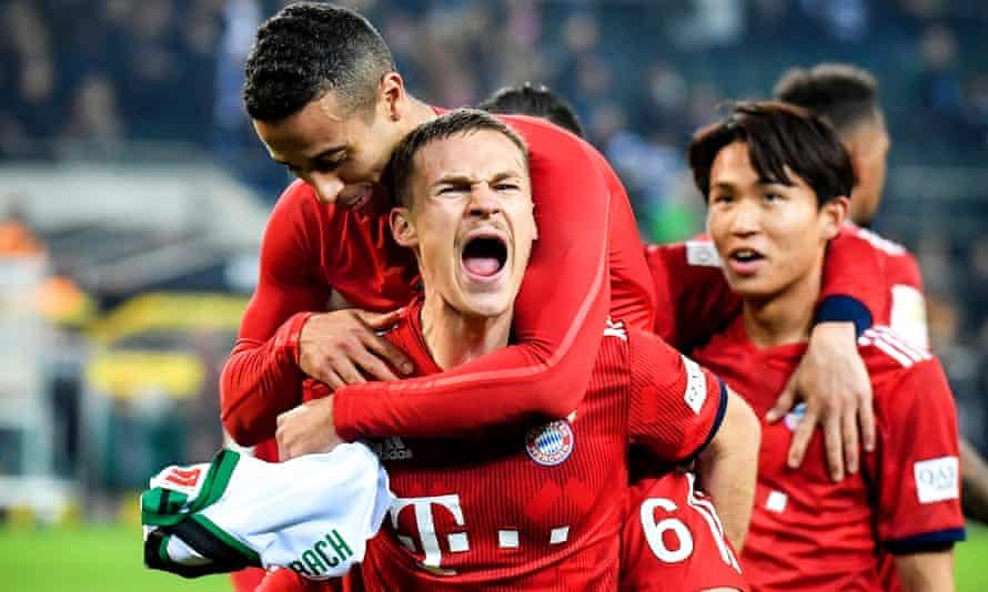 Bayern's Joshua Kimmich and teammate Thiago celebrate victory over Borussia Mönchengladbach.