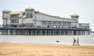 People stroll on the beach at Weston-super-Mare