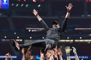Liverpool manager Jurgen Klopp is thrown into the air by players.