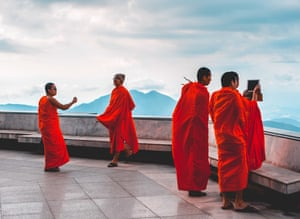 By Thomas Sweetman. Monks at Doi Inthanon, the highest mountain in Thailand. It was a quiet day and at first I saw no one at the top, but I walked round the back of the pagoda to find this group of young monks enjoying the view and capturing it with an iPhone and iPad.