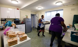 Volunteers from Children with Voices community food hub prepare parcels for vulnerable residents of Hackney, London, on 23 April. Photograph: Kate Green/Getty Images