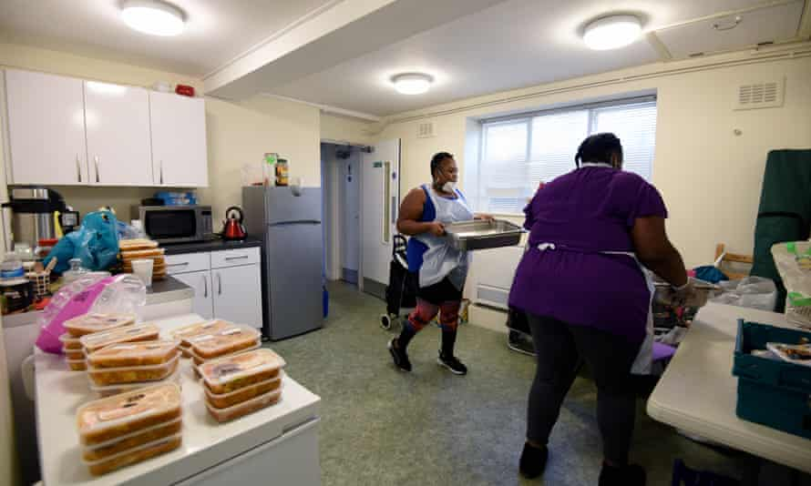 Volunteers from 'Children with Voices' community food hub prepare food parcels for vulnerable residents of Hackney, London, at Wilton estate community Hall on 23 April.