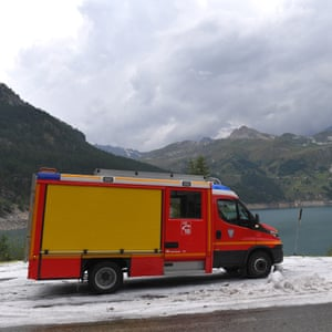 Emergency vehicle stands in snow after stage 19 was cancelled due to snow and hail in the final 20km to the finish line in Tignes.