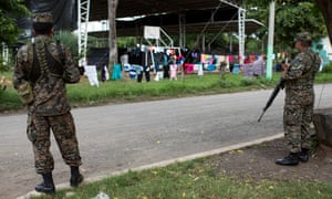 Militars are in charge of the 24 hour security of the shelter for displaced people in Caluco, Sonsonate.