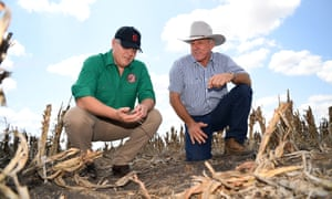 Scott Morrison (left) inspects the dry soil with farmer David Gooding on his drought-affected property near Dalby in Queensland.