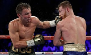 Gennady Golovkin connects with a left to Canelo Álvarez during their title fight in 2017