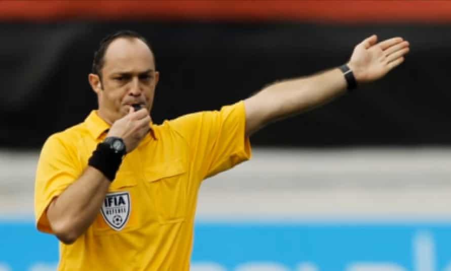 Son of a Bitch ... Juarez Gomez (Eucir de Souza) blows the whistle.