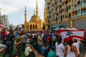 People waiving flags during a demonstration in Martyrs' Square on 17 July, 2020. People gather to demonstrate in support of pensioners of the Lebanese Armed Forces who saw their pensions cut from 800$ - 1000$ to 150$ - 200$.
