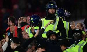 Riot police are deployed to keep an eye on the fans.