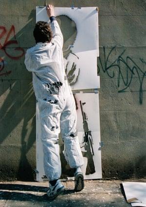 'I'll never give him up' … Banksy at work.