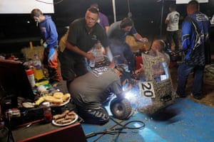 """The Robbindreams Mowersports team perform some emergency welding to their mower in the middle of the night. Derrick Robinson, one of the team members, from South Carolina, USA, said: """"We don't do any endurance (lawnmower) races like this back home and we run on smooth oval tracks. Everyone said it was so hard to do and actually finish but I had a ball."""""""