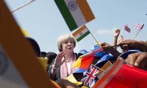 Theresa May watches a flypast by the Indian Air Force with pupils at Stonehill government primary school in Bangalore
