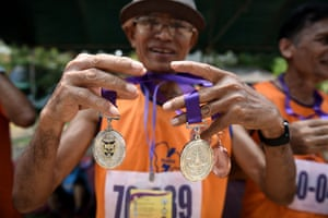 A competitor shows off his medals